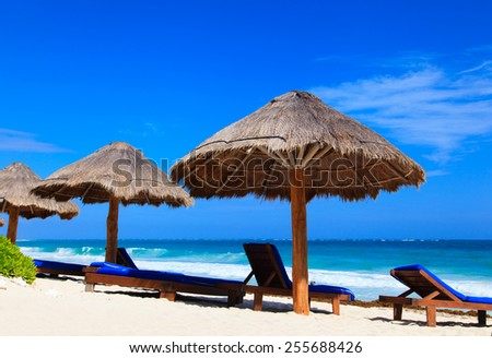 Beach chairs on exotic tropical white sand beach - stock photo