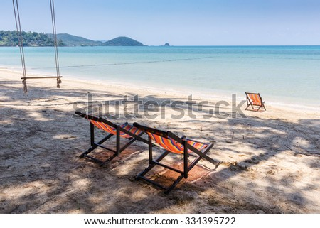 Beach chairs on idyllic tropical sand beach.