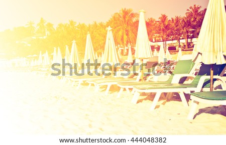 Beach chairs on tropical white sand beach with color filters - stock photo