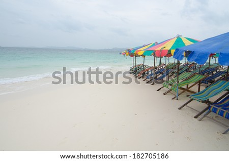 Beach chairs with umbrella and beautiful beach.Khai Nok Island Phuket