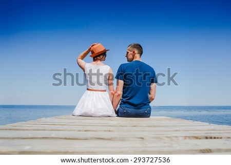 Beach couple enjoying fun romantic vacation holiday - stock photo