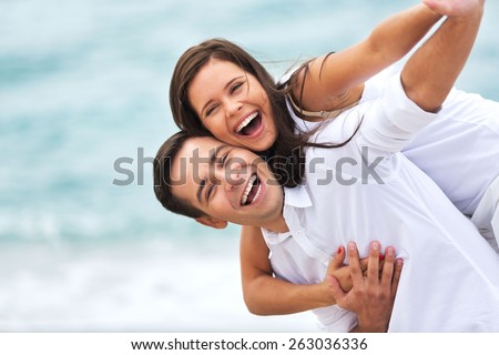 Beach. Couple having fun on the beach - stock photo