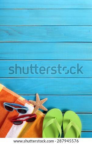 Beach couple sunbathing background, sunglasses, copy space, vertical - stock photo