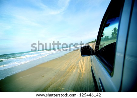beach drive on allroad car - stock photo
