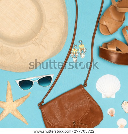 Beach female outfit in beige colors on azure background - stock photo