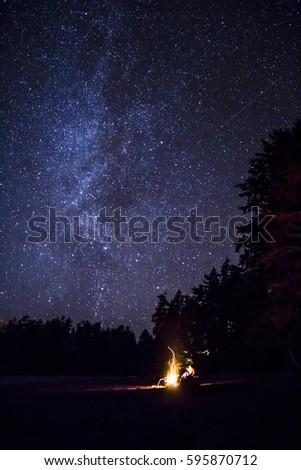 Beach fire underneath a canopy of stars. & Beach Fire Underneath Canopy Stars Stock Photo 595870712 ...