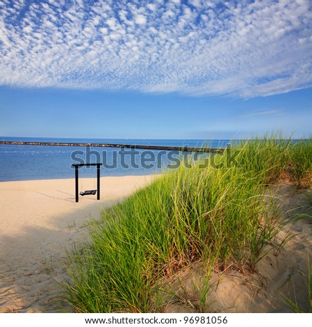 Beach Grass And A Beach Swing At The Frankfort North Breakwater On An Early Summer Morning, Lake Michigan At Frankfort Michigan, USA - stock photo