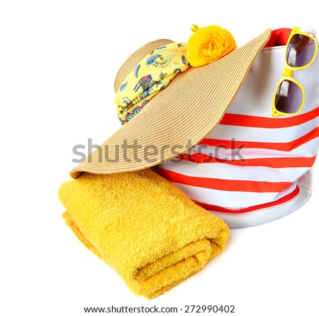 Beach hat with bag, sunglasses and towel. Colorful summer beach accessories. Isolated on white background  - stock photo