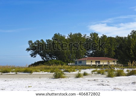 Beach House on the Florida Gulf Coast with a Grove of Trees for Shade - stock photo