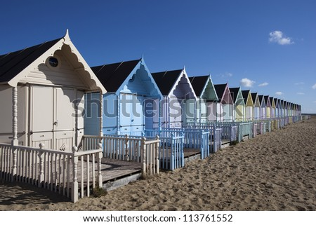Beach Huts against a blue sky at West Mersea, Essex, England