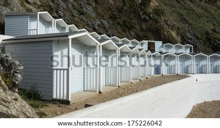 Beach huts at Lusty Glaze Beach, Newquay, Cornwall, UK. - stock photo