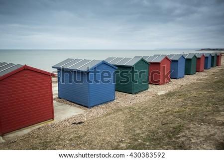 Beach huts at seaside - stock photo