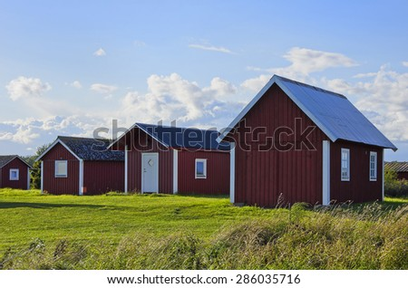 Beach Huts - Cabins, beach houses, boathouses, fishing huts on the Swedish island of Oland in the evening light.