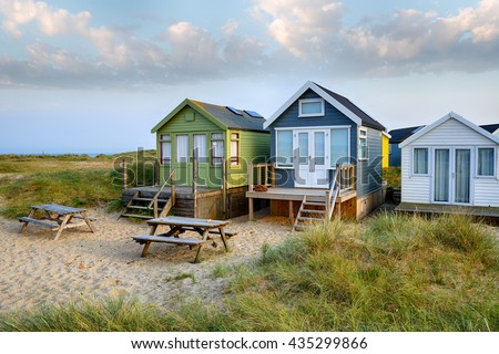 Beach huts on Mudeford Spit a narrow strip of sand between Hengistbury head and Mudeford at Christchurch in Dorset - stock photo