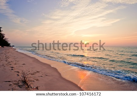 Beach in Cha-am, Thailand. Shoot in the morning with amazing sunrise sky. - stock photo