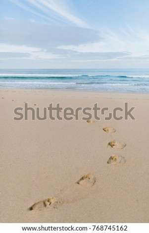Beach in Portugal with footsteps