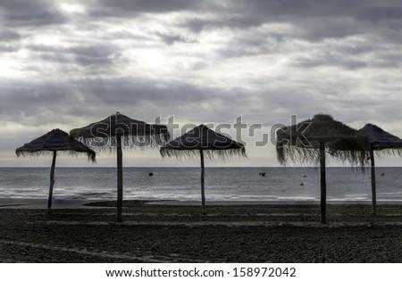 Beach in rainy weather - stock photo
