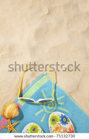 beach items on a towel with copy-space - stock photo