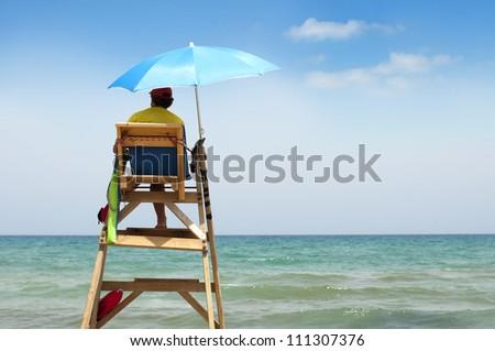 Beach lifeguard on duty. - stock photo