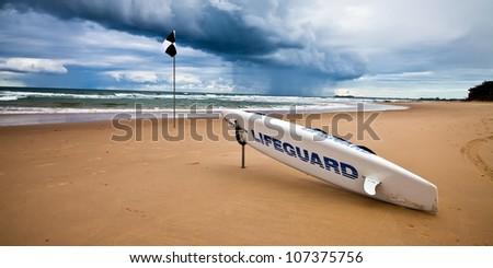 Beach lifeguard surf board - stock photo