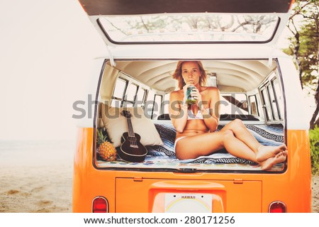 Beach Lifestyle, Beautiful Surfer Girl on the Beach at Sunset with Classic Vintage Surf Van - stock photo