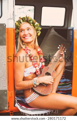 Beach Lifestyle, Beautiful Surfer Girl with Ukulele and Classic Vintage Surf Van on the Beach at Sunset - stock photo