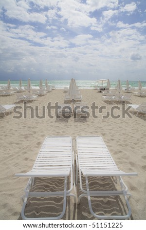 Beach Lounge Chairs and Umbrellas - stock photo