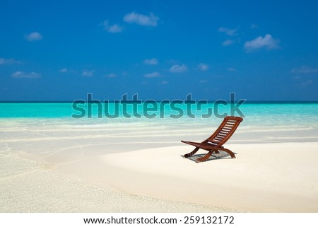 Beach lounger on sand beach. - stock photo