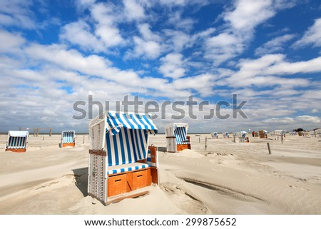 beach loungers on the deserted coast sea at sunny morning, perfect vacation concept. - stock photo