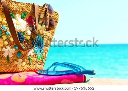 Beach necessities,against blue sea horizon. - stock photo