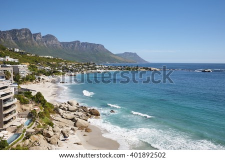 Beach of Camps Bay with Twelve Apostles Mountains in background, Cape Town, South Africa.