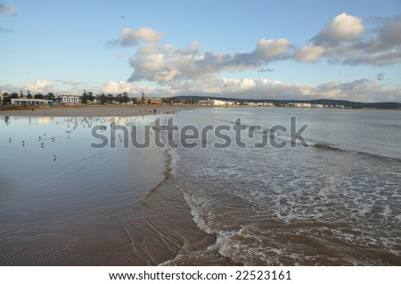 Beach of Essaouria on a cloudy day, Morocco Africa - stock photo