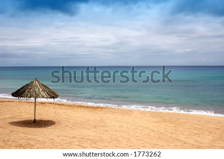 beach of sand with sun hat waiting for me - stock photo