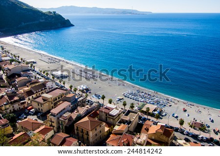 Beach of Scilla, Calabria, with Messina, Sicily, in the Background (Italy) - stock photo