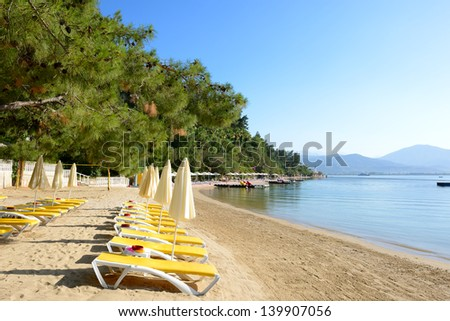 Beach on Mediterranean turkish resort, Fethiye, Turkey - stock photo