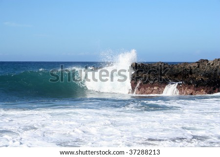 Beach on Tenerife. Black volcanic sand and waves. - stock photo