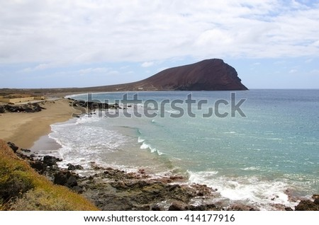 Beach Playa de la Tejita with Montana Roja, red mountain. Tenerife  Canary Island, Spain