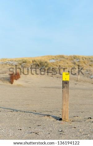 Beach Pole at Dutch wadden island Texel - stock photo