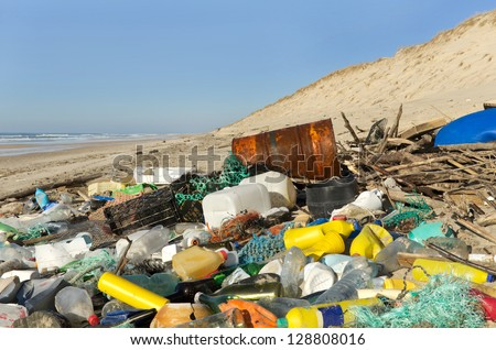 Beach pollution. Every day, waste accumulates on the beach of Atlantic west coast, they arrive from Spain with ocean currents effect. - stock photo