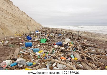 Beach pollution. garbage, plastic, and wastes on the beach after winter storms - stock photo