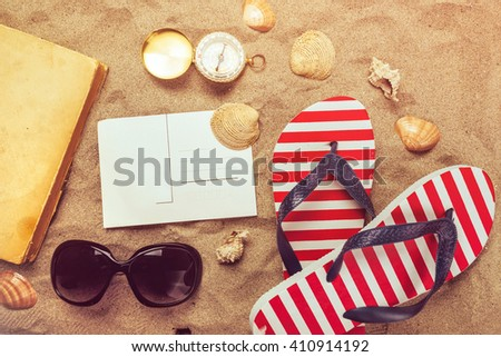 Beach ready, summer holiday vacation accessories on sandy beach, summertime lifestyle objects in flat lay top view arrangement. - stock photo