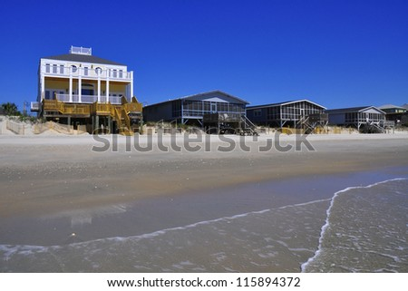 Beach rentals homes on a Summer day - stock photo
