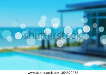 beach resort concept with bungalow and bokeh. - stock photo