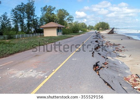 Beach Road slide along the beach  to water erosion - stock photo