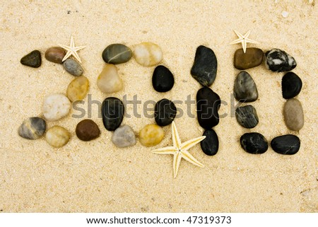 Beach rocks making a date in the sand, vacation 2010 - stock photo