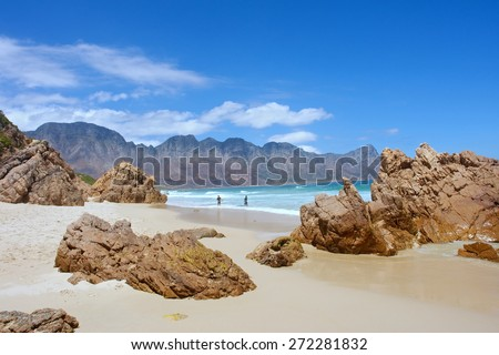 Beach, rocks, mountains. Shot near Strand/Cape Town, Western Cape, South Africa.  - stock photo