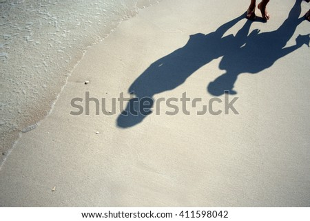Beach, sand - two people on the beach - stock photo