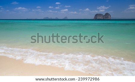 Beach, Sand, Wave, Blue Sea and center rock island (with eye point), summer travel in Thailand - stock photo