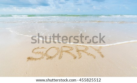 "beach sand with text write on it ""SORRY"""