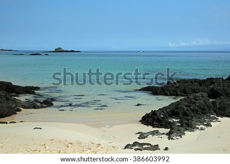 Beach scene with lava formations, coast of Galapagos Islands  - stock photo